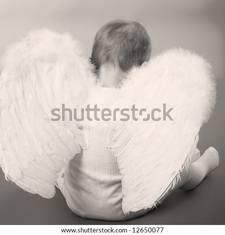small boy dressed as Cupid, black and white, blue tone