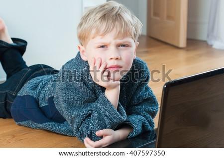 Small boy happy to use modern technology - stock photo
