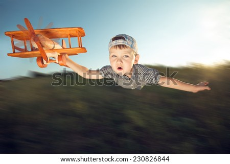 small boy playing with plain - stock photo