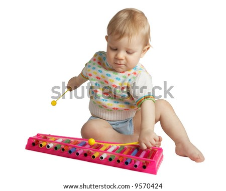 Small boy plays a musical toy - stock photo