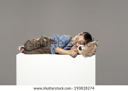 small boy sleep with bear - stock photo