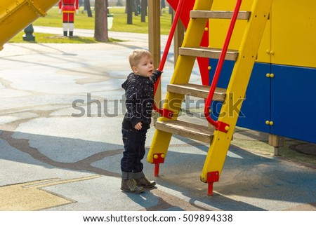 Small boy staying near the ladder