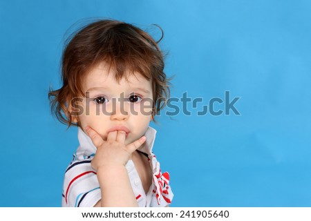 Small boy sucking fingers - stock photo