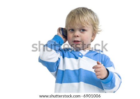 Small boy talking on a cell phone