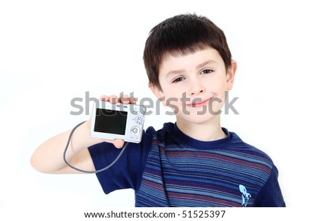small boy with digital camera on white background