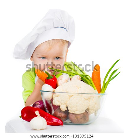 small boy with vegetables isolated on a white background - stock photo