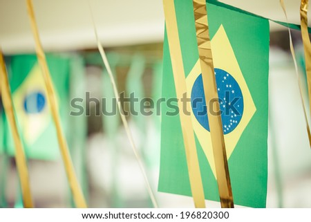 Small Brazil flags commonly used to decorate streets to support soccer cups. Instagram or vintage style.