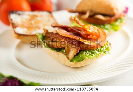 Small Breakfast Sandwiches with Bacon, Greens,Tomatoes and Coffee - stock photo