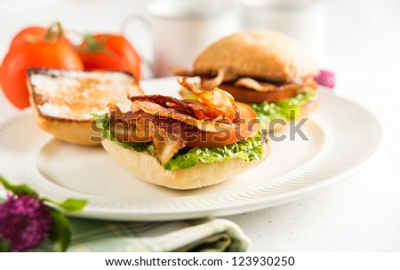 Small Breakfast Sandwiches with Bacon, Greens,Tomatoes and Coffee