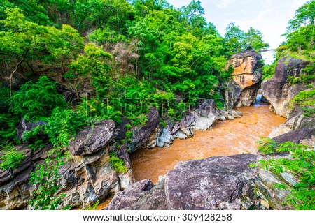 Small bridge over the river with big cliff at Ob Luang National Park, Thailand. - stock photo