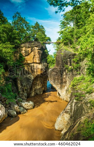 Small bridge over the river with big cliff at Ob Luang National Park, Thailand.