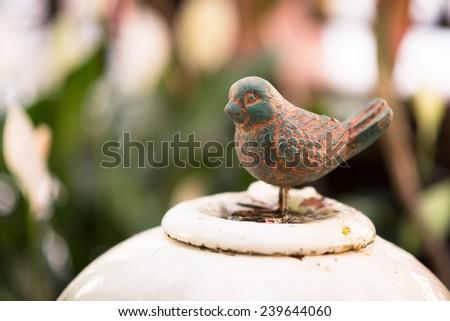 Small bronze bird deccorate in garden - stock photo