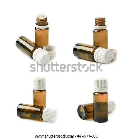 Small brown glass flask vial, composition isolated over the white background, set of four different foreshortenings - stock photo