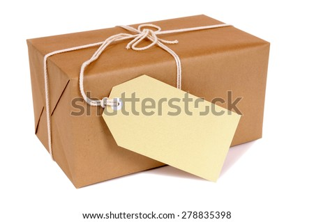 Small brown parcel package, manila label, isolated - stock photo