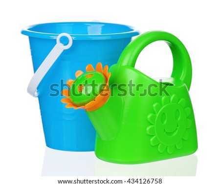 Small bucket and watering can, isolated on white background  - stock photo