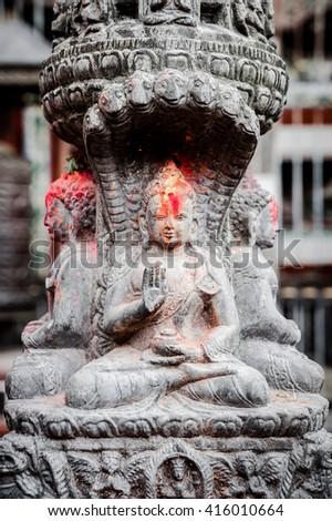 Small buddha statue in Ratnakar Mahavihar, the Kumary's Palace, in Pantan, Nepal - stock photo