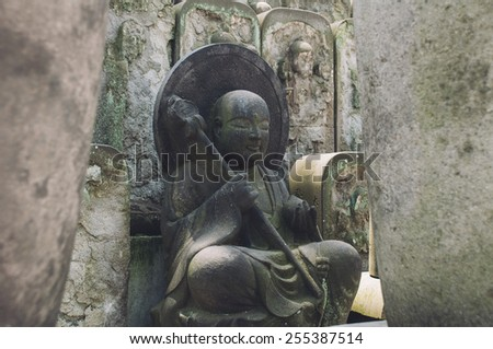 Small Buddha statue of rock in Japan - stock photo