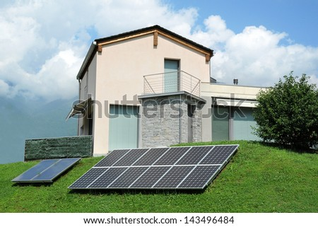 Small building with solar panels in the backyard - stock photo