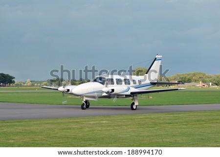 Small business airplane landing - stock photo