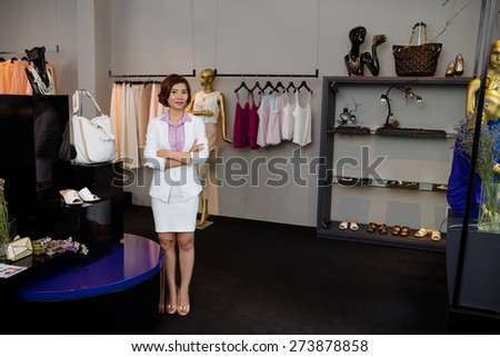 Small business: beautiful owner of clothing store - stock photo