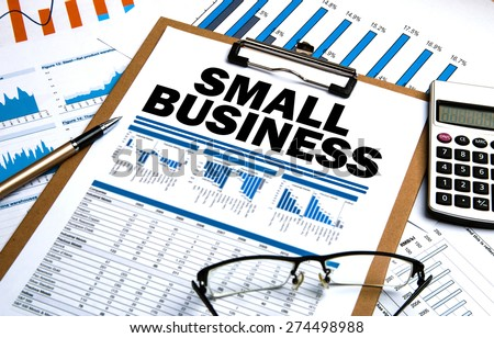 small business concept on clipboard - stock photo