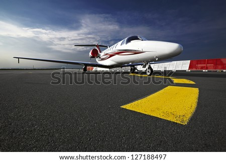 Small business jet plane on a runaway