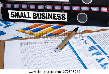 small business research concept on folder with financial chart - stock photo