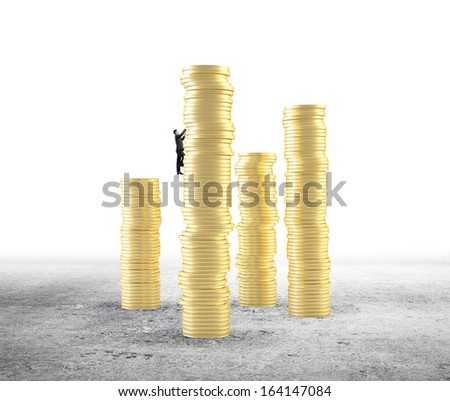 small businessman climbing on gold coin tower