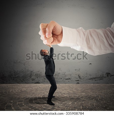 Small businessman crushed by a big punch - stock photo