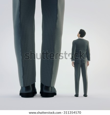Small businessman looking at his big boss - stock photo