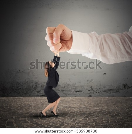 Small businesswoman crushed by a big punch - stock photo