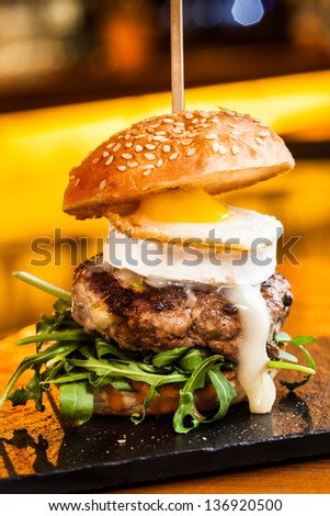 Small but great burger. A different burger. - stock photo