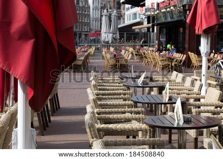 Small cafe tables outside on a street