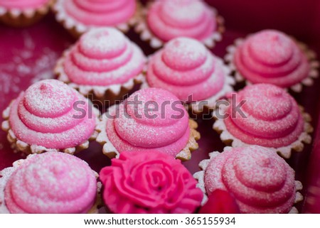 Small cakes with different stuffing.Tasty dessert with summer fruits. Cupcakes with fruits. Cake with icing and fresh berry. - stock photo