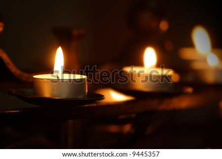 small candles in rows in a church