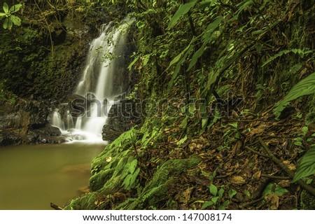 Small cascade located in a valley near El Cajon de Grecia. - stock photo