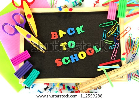 Small chalkboard with school supplies on white background. Back to School - stock photo