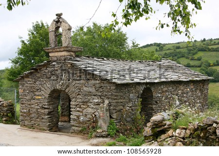 small chapel built with traditional stone at o camino de santiago - stock photo