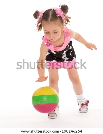 Small charming girl plays with the ball on white background - stock photo
