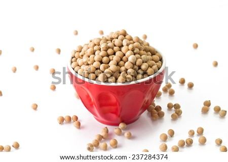 Small chickpeas in a red bowl on a white background - stock photo
