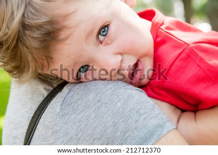 small child crying at her mother's hands - stock photo