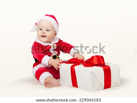 small child dressed as Santa Claus