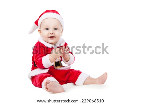 small child dressed as Santa Claus - stock photo