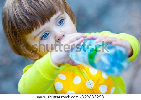small child drinking water - stock photo