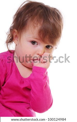 small child holding a finger in his mouth. studio photos. Close-up portrait. isolated on white - stock photo