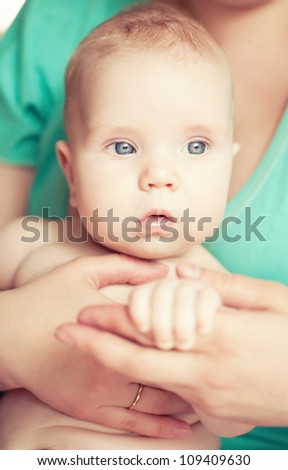 small child holding the handle of the mother