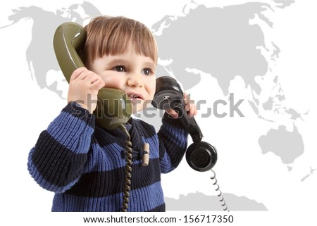 small child in a call center with two phones - stock photo