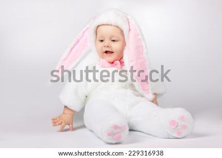 small child in a white bunny costume - stock photo