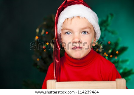 Small child in santa hat - stock photo