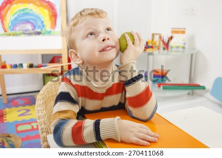 small child in the classroom - stock photo